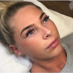 a woman with micropigmentation brows